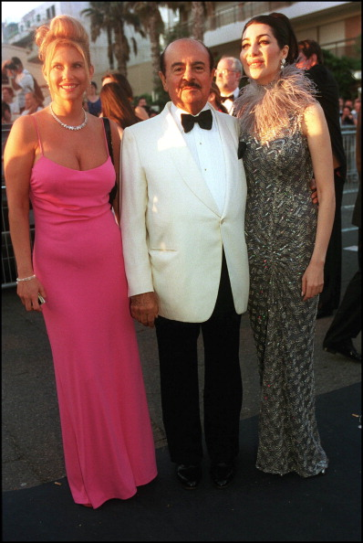 FRANCE - MAY 18:  AMFAR charity gala evening : the arrival of the guests at the Palm Beach In Cannes, France On May 18, 2000-Adnan Khashoggi and wife.  (Photo by Pool BENAINOUS/DUCLOS/Gamma-Rapho via Getty Images)